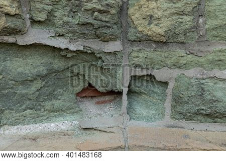 Green Limestone Wall Eaten Away To Show Brick Beneath, Effects Of Decay And Pollution, Horizontal As