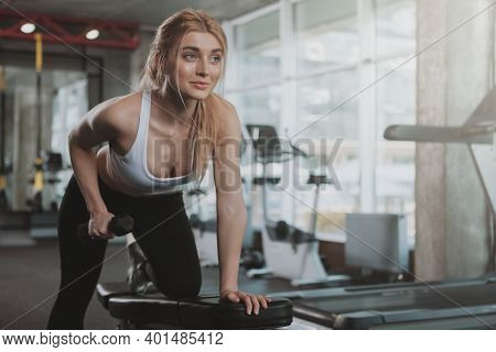 Happy Beautiful Female Athlete Smiling, Doing Triceps Exercise At Sport Studio, Copy Space. Lovely F