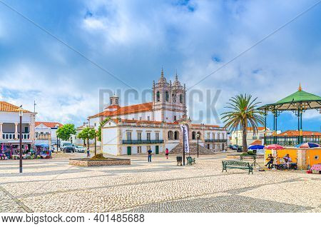 Nazare, Portugal, June 22, 2017: Sanctuary Of Our Lady Of Nazare Catholic Church And Street Misician