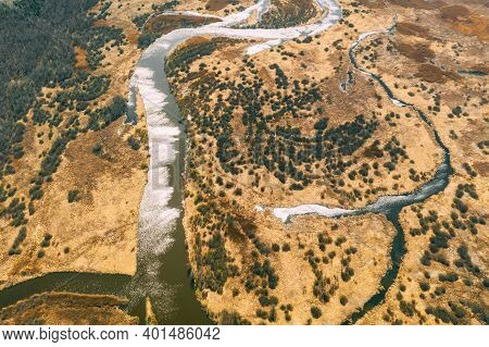 Aerial View Curved River In Early Spring Landscape. River Bends Curves And Dry Grass Landscape. Top