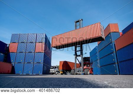 Wide Shot Of Crane Truck Level Up Cargo Container Tank Also Show Stack Or Layer Of Containers With D