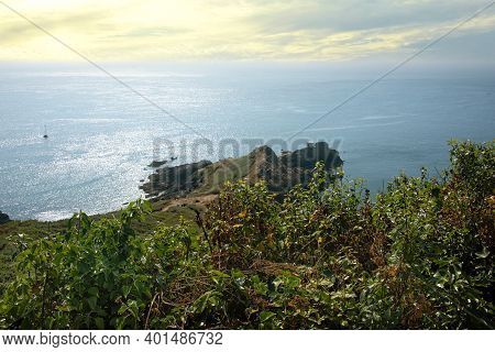 Shoreline And Countryside Of Guernsey, A Channel Island In The English Channel