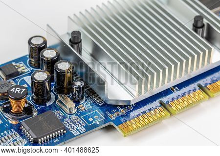 Blue Circuit Board Showing On Board Cooler And Electronic Components