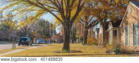 Panoramic View Residential House With Beautiful Autumn Leaves In Suburban Subdivision Near Dallas, T