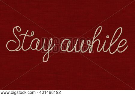 Cursive Font Stay While Text In Rope Effect On A Textured Red Background