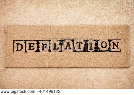 Cardboard With Word Deflation Made By Black Alphabet Stamps.