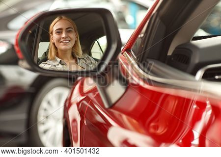 Close Up Of A Side Mirror Of A New Car At The Dealership With The Reflection Of A Beautiful Woman Si