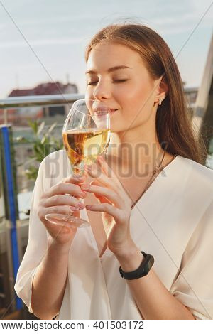 Vertical Cropped Shot Of A Beautiful Happy Woman Smelling Delicious Wine, Drinkin Gon Sunset Outdoor