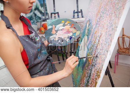 Cropped Shot Of A Young Woman Enjoying Painting A Picture At Art Class, Holding Palette With Oil Pai
