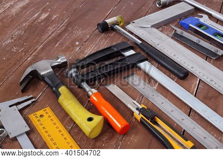 Closeup Tools Building And Repair Set On A Wooden Background