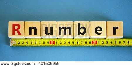 R - Reproduction Number Symbol. Wooden Cubes With Word R - Reproduction Number Arranged Behind The R
