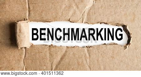 Benchmarking, Text On White Paper On Torn Paper Background
