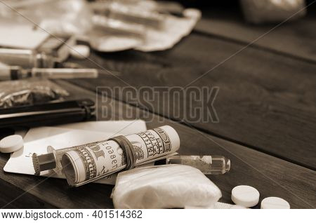 A Lot Of Narcotic Substances And Devices For The Preparation Of Drugs Lie On An Old Wooden Table. Dr