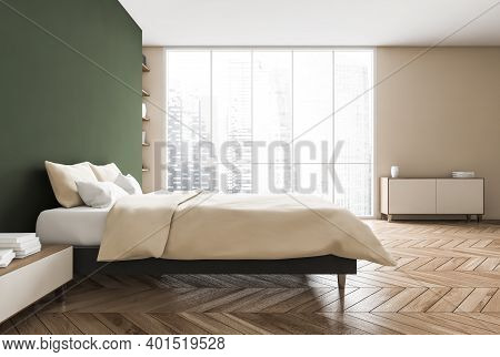 Green And Beige Bedroom, Bed With Pillows And Linens, Side View, Coffee Table With Books. Green Wall