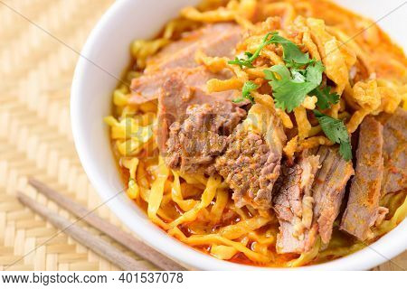 Northern Thai Food (khao Soi), Spicy Curry Noodles Soup With Beef In A Bowl And Chopsticks, Close Up