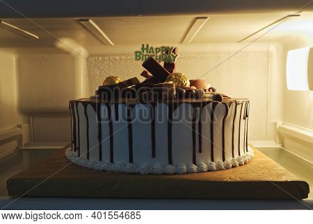 Details Of Beautifully Decorated Birthday Cake In Fridge.