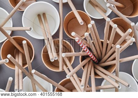 Drinking Brown Tubes Straws Made Of Paper And Cornstarch In Empty Paper Coffee Cups On A Trendy Grey