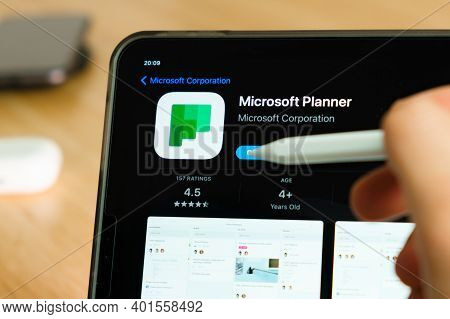 Microsoft Planner Logo Shown By Apple Pencil On The Ipad Pro Tablet Screen. Man Using Application On