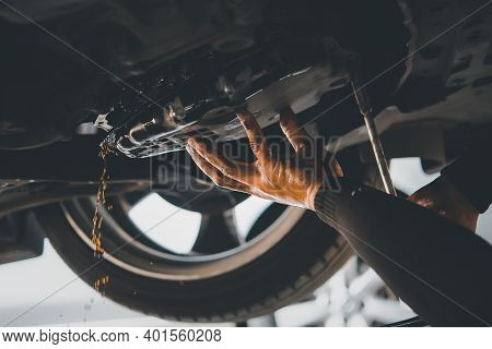Car Mechanic Drain The Old Automatic Transmission Fluid (atf) Or Gear Oil At Car Garage For Changing