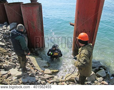 Construction Work Of A Coal Berth, Metal Piles, Lifting Diver From  Depth To  Rocky Shore After Tech