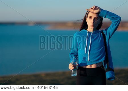 Thirsty Sporty Woman With Yoga Drinking Water