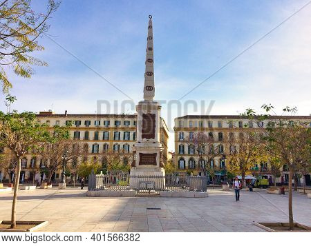 Malaga, Spain, April 2016: Obelisk At The Plaza De La Merced In Which Is In Honour Of General Torrij