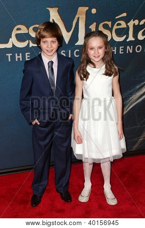 "NEW YORK-NOV 18: Actors Daniel Huttlestone and Isabelle Allen attend the premiere of ""Les Miserables"" at the Ziegfeld Theatre on December 10, 2012 in New York City."
