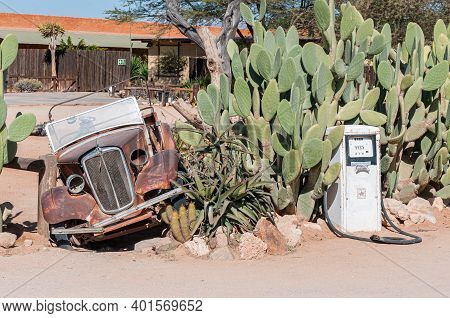 Solitaire, Namibia - June 22, 2012: A Vintage Car And Old Fuel Dispenser In Solitaire