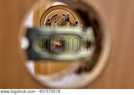 An Carpenter Shoves The Door Handle Spindle Through The Face Bore And The Latch Assembly.