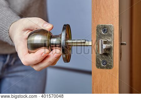 Handyman Pushes The Door Knob Spindle Through The Face Bore And The Latch Assembly.