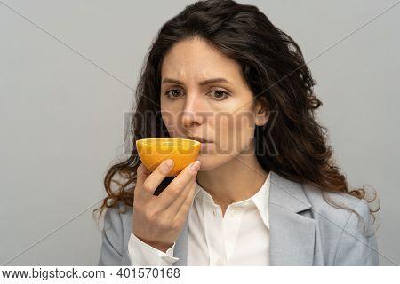Sick Business Woman Trying To Sense Smell Of Half Fresh Orange, Has Symptoms Of Covid-19, Corona Vir