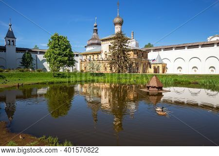 Courtyard Of The Rostov Kremlin, Church Of Hodegetria Is Reflected In Water Of Pond. Rostov Veliky,