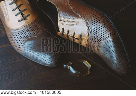 Men Shoes And Perfume On Wooden Background