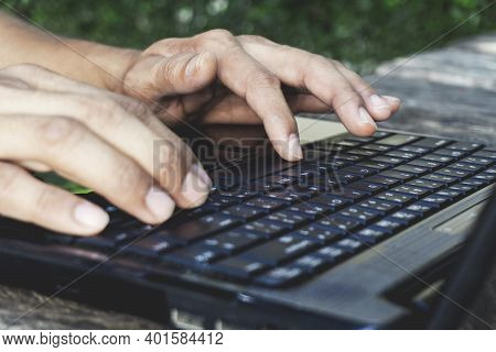 Hand Person Working And Using On A Laptop Computer For Freelance With Input Keyboard For Online Blog