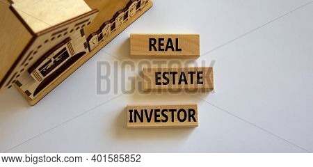 Real Estate Investor Symbol. Wooden Blocks With Words 'real Estate Investor' Near Miniature House. B