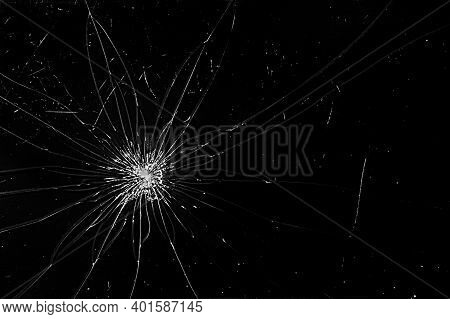 Broken Screen Cracks. Broken Smartphone Screen. Cracks Spread Across The Black Glass. Cracked Screen