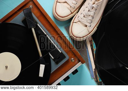 Vinyl Player With Vinyl Record Albums, Retro Sneakers On Blue Background. Top View
