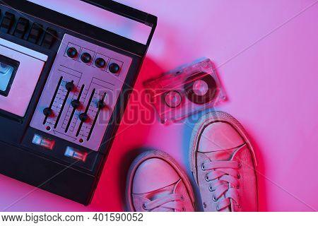 Retro Audio Tape Recorder, Audio Cassette, Sneakers In Pink Bue Gradient Neon Light. Retro Media. 80
