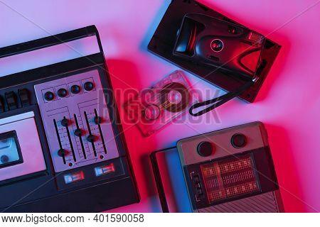 Retro Audio Tape Recorder, Audio Cassette, Camera, Radio Receiver In Pink Bue Gradient Neon Light. R