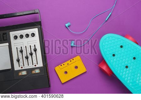 Hipster Stuff. Retro Audio Tape Recorder, Cruiser Board, Earphones And Audio Cassette. Top View. 80s