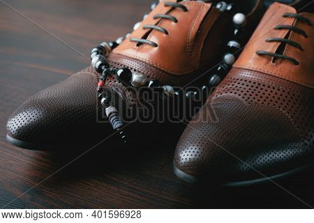 Men Shoes And Accessories On Brown Wooden Background