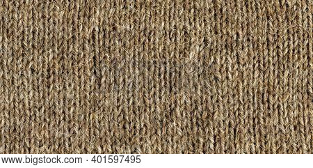 Wool In Knitted Fabric. Coarse Natural Wool, Natural Sheep Wool Color
