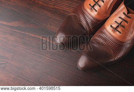 Men Shoes On A Brown Wooden Background