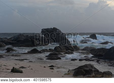 Shoreline With Stunning Rock Formations Along The Coast.