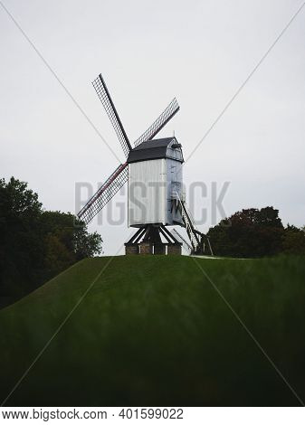 Panoramic View Of Historic Traditional Bonne Chieremolen Windmill Post Mill In Bruges West Flanders