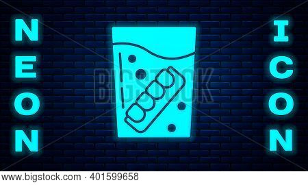 Glowing Neon False Jaw In Glass Icon Isolated On Brick Wall Background. Dental Jaw Or Dentures, Fals
