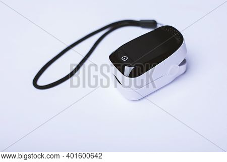 Pulse Oximeter Isolated On White Background. It Is Used For Monitoring A Person's Oxygen Saturation.