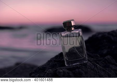 Perfume Bottle On The Background Of The Sea