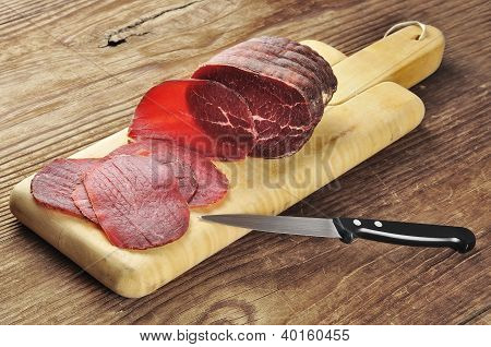 Sliced Bresaola On A Cutting Board