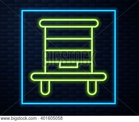 Glowing Neon Line Hive For Bees Icon Isolated On Brick Wall Background. Beehive Symbol. Apiary And B